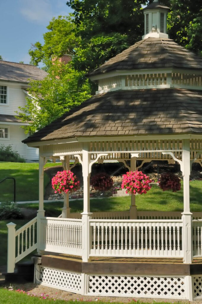 Hanging planters make for stunning accessories to gazebos that quickly amplify the color and appeal of the structure.