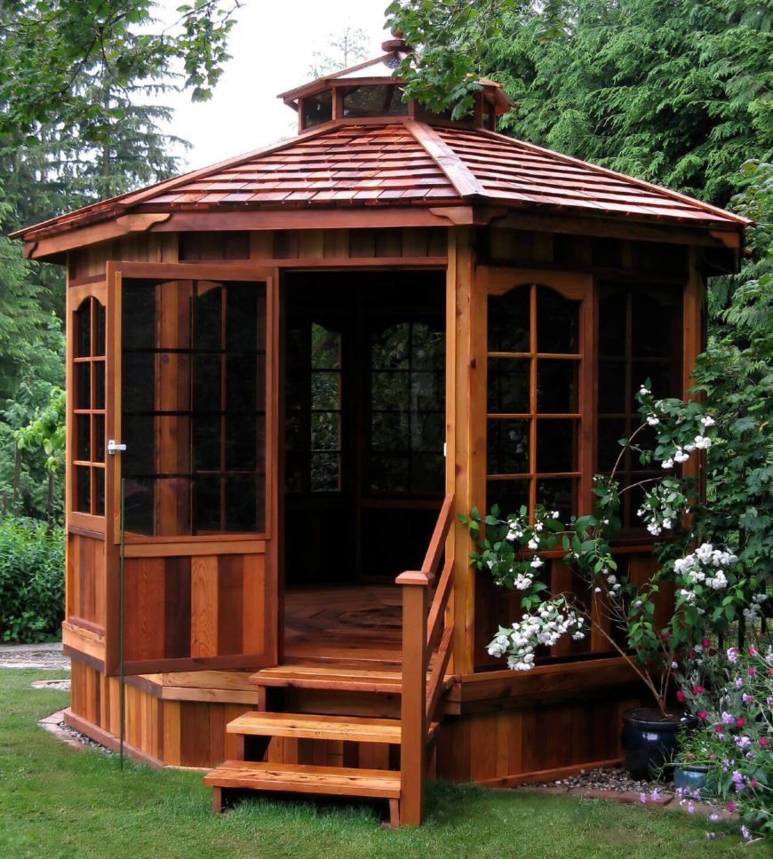 This high end gazebo comes equipped with walls and doors that have been fitted with screens. This is a fabulous place to sit and relax and enjoy the outside without any concern that bugs will spoil your time.