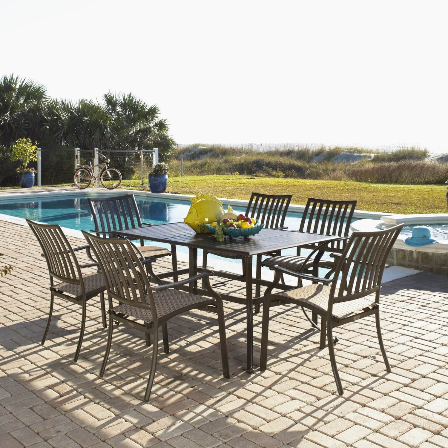Here is a simple set of patio furniture set poolside on a stone patio. While simplistic, these chairs can be quite comfortable and relaxing.