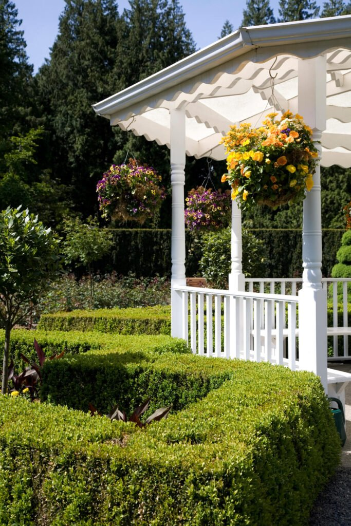 Simple potted plants with hanging flowers are a classic and lively feature for any structure. A bright and vibrant addition, they make your gazebo feel like home.