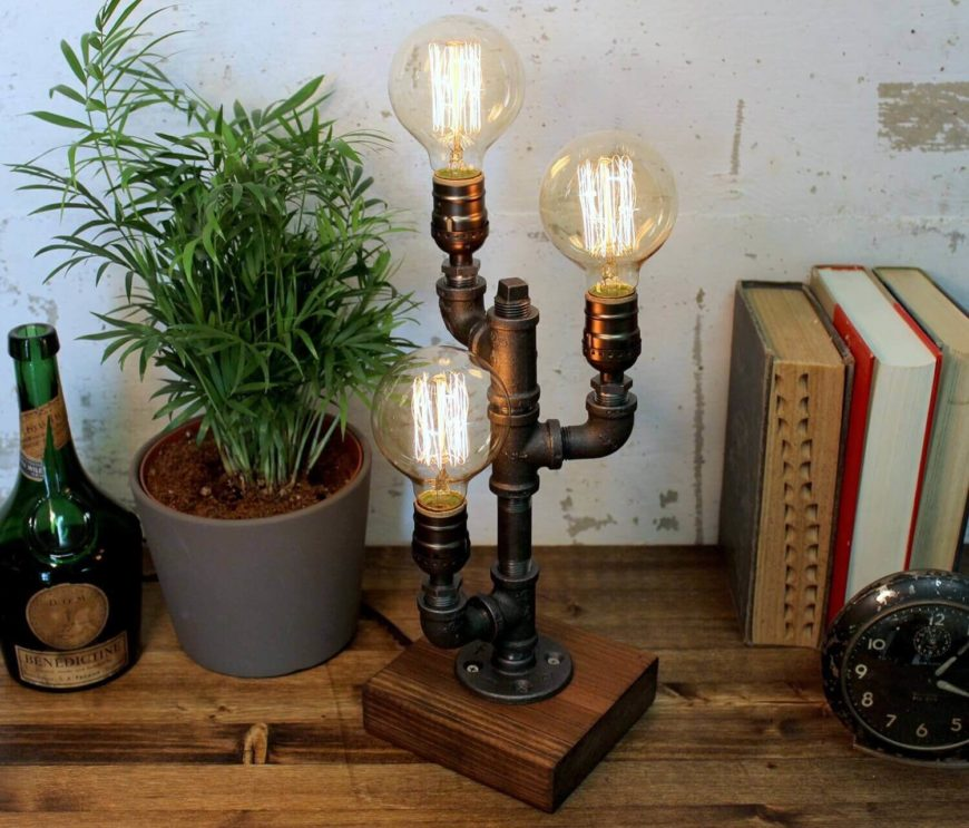 This handcrafted table lamp has three Edison bulbs and a base made from re-purposed wood. The antique sockets support a maximum of 60 watts. The lamp has an 8 foot cord with an on-off clicker.