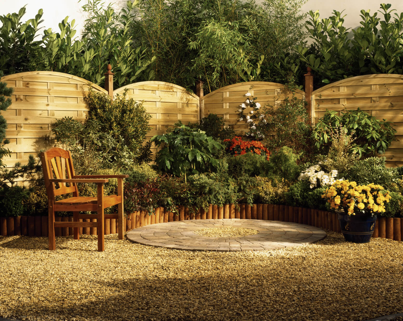 Small gardens are great for filling otherwise unused space. Here is a small garden along a fence. Fences make great backdrops for gardens. They can add some extra elements to your security.
