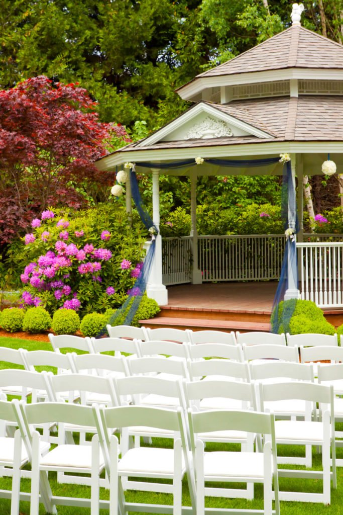 This gazebo is set up for special events with these lovely blue drapes. The drapes bring class and pomp and circumstance to the structure, making it perfect for weddings and elegant parties.