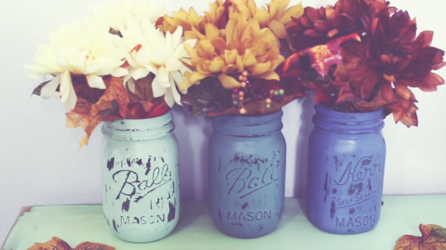 These adorable vases are made from painted vintage mason jars and a little sandpaper is used to create a neat worn effect. This is a super simple DIY project that looks great with traditional farmhouse style homes, industrial, shabby chic, and many many more!