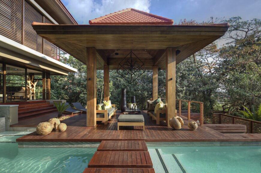 This gazebo houses a great set of patio furniture. The furniture builds a great casual space for guests to hang out close to the pool in case they have the desire to swim.