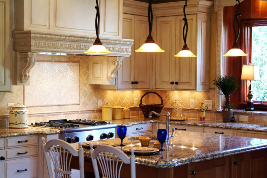There are many places in your kitchen that can benefit from great ornamental design. In this kitchen there is a fantastic ornamental oven hood with plenty of complex and curved lines, which builds great interest and depth.