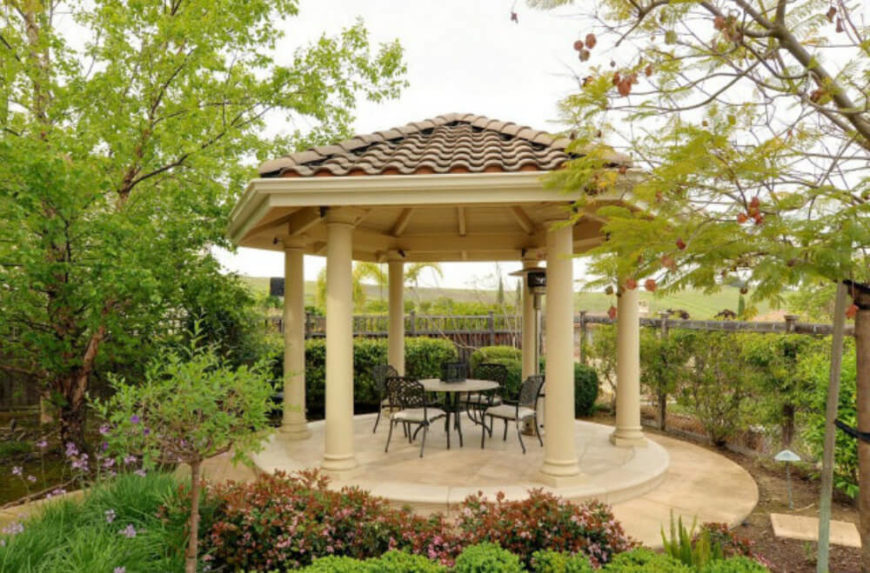 This gazebo is reminiscent of old Grecian architecture with tall white pillars. This is a nice classic design that is both elegant and long lasting.