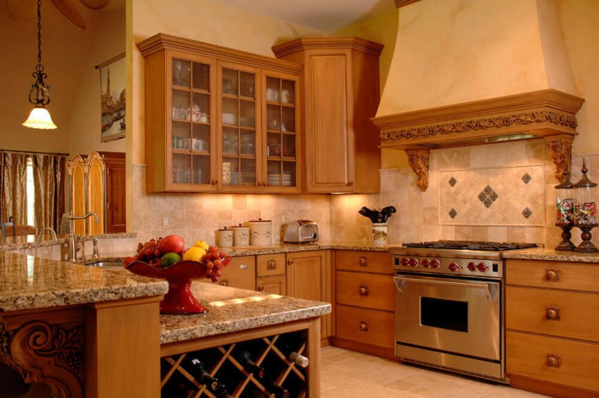 When using tiles you can arrange them in any way imaginable. Small designs and patterns like the one used behind the stove in this kitchen are perfect for providing a sense of organization to your tiled spaces.