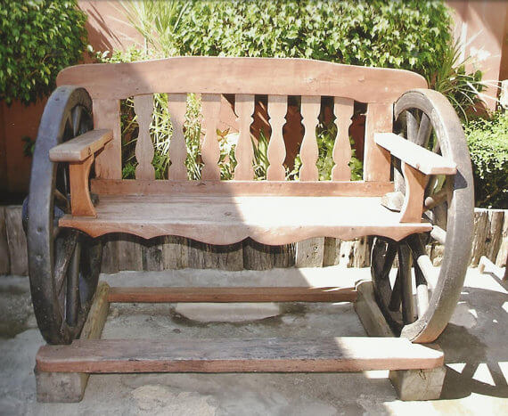 Wood material, wheels and rustic look; this is no doubt a reclaimed vintage cart garden bench.
