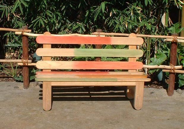 The maker of this garden bench calls it a Popsicle stick bench. The design is indeed creative and decorative.