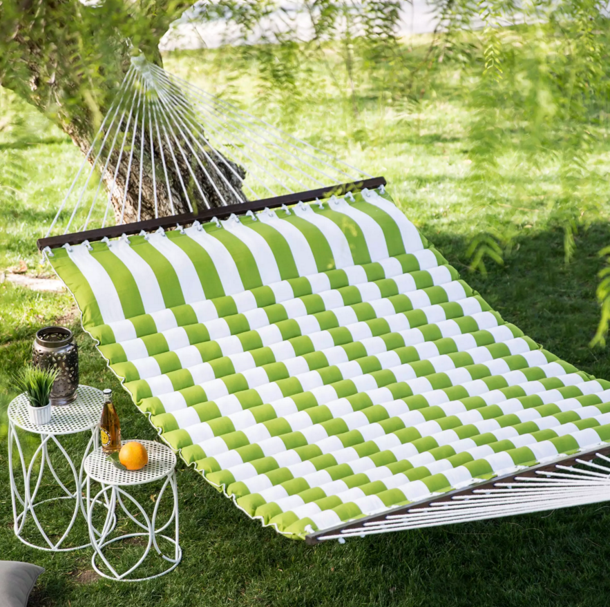This tree hung padded hammock is extra wide so that it can fit multiple people. What is better than lying suspended under a shady tree and gently swinging in the breeze? Doing it with someone else, of course!