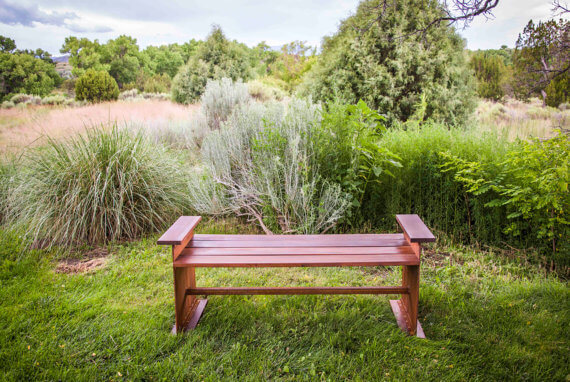 Crafted from one-fourth inch welded steel plate and Ipe wood, this bench is stable, long lasting and does not require much maintenance.