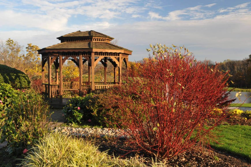 A garden gazebo overlooking a lake is a stupendous place to watch the sun set. It is a comfortable and serene setting to watch time tick away.
