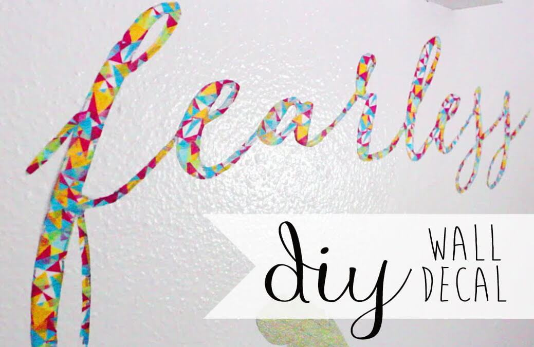 This adorable decal looks like it was difficult to make, but it's a very simple DIY that only requires patience and a little care to do right. These decals are easy to remove and won't damage walls, making them great for dorm rooms!