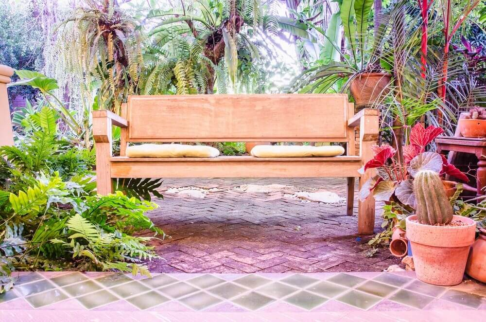 Cushions are laid on this bench for a more comfortable experience when sitting and savoring the abundance of nature.