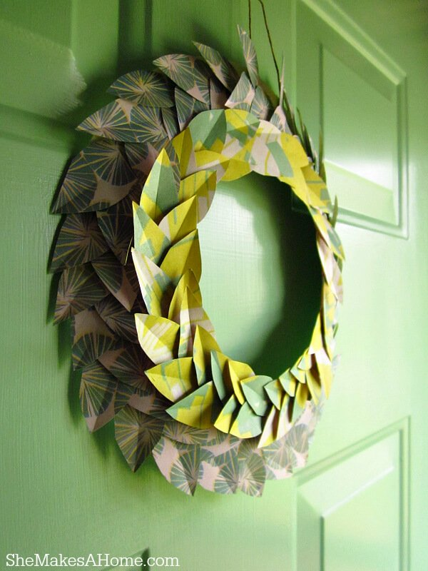 It can be hard to find a place to make use of old scraps of wrapping paper. This project will have you using up your old scraps, ending up with an adorable new wreath that you'll love to display.