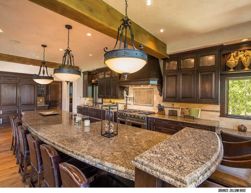 Islands build a level of grandeur to any kitchen space. This island seats a number of people and perfectly encapsulates this open concept Mediterranean kitchen space.
