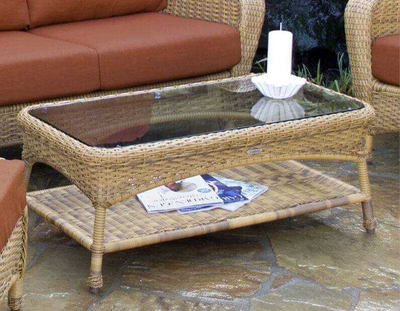 This weaved coffee table with glass top has a touch of extra storage with a shelf under the table top. This can make your outdoor gathering space feel more like a living room with a cool breeze.