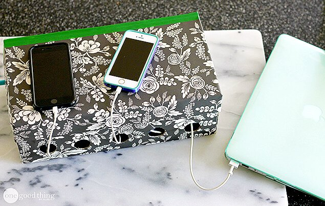 Phone charging cords can get messy and clutter up an otherwise clean and tidy space. This DIY will have your cords wrangled and safely hidden out of sight! No more tangled cords!