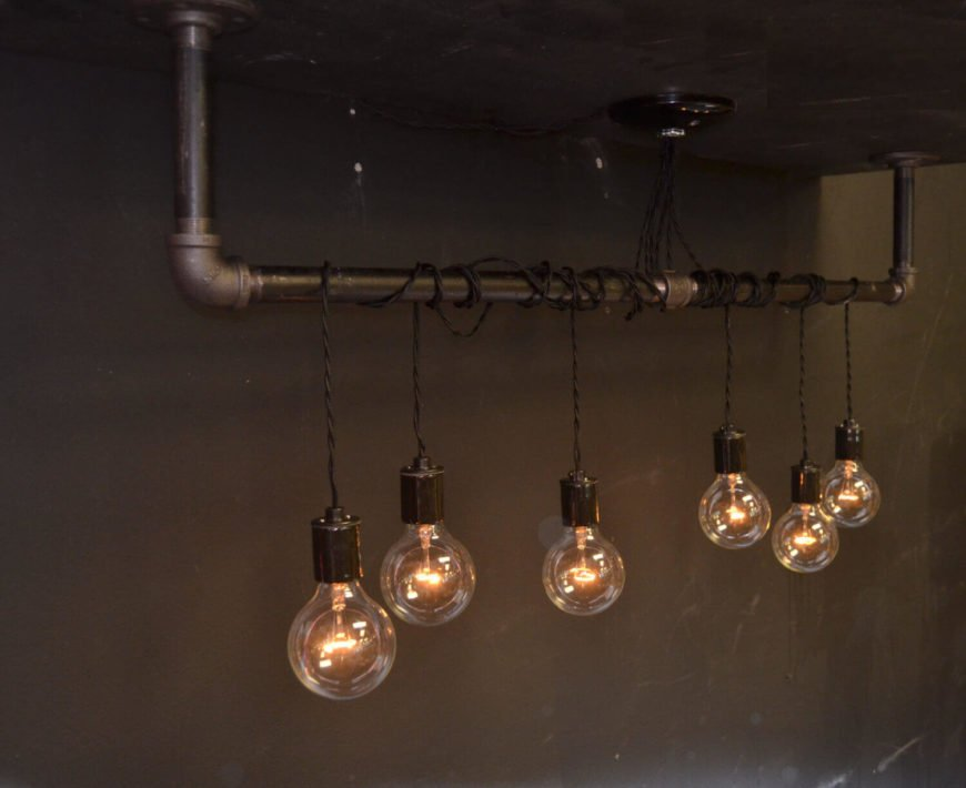 This light includes the hanging bar as well as the hanging lights wound around the bar. All pendants are completely adjustable on their vintage pendant cords.