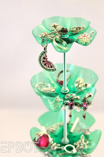 This clever recycled jewelry stand is made from large liter water bottles. For color, you can choose a different kind of bottle, like a Mountain Dew bottle.