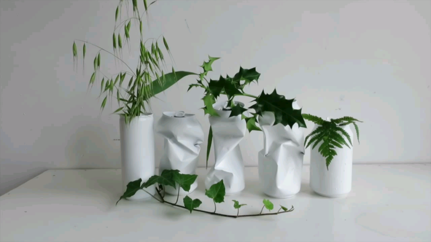 This is a unique planter idea that looks a lot like a minimalist art installation. The bold white with crushed cans is an awesome juxtaposition!