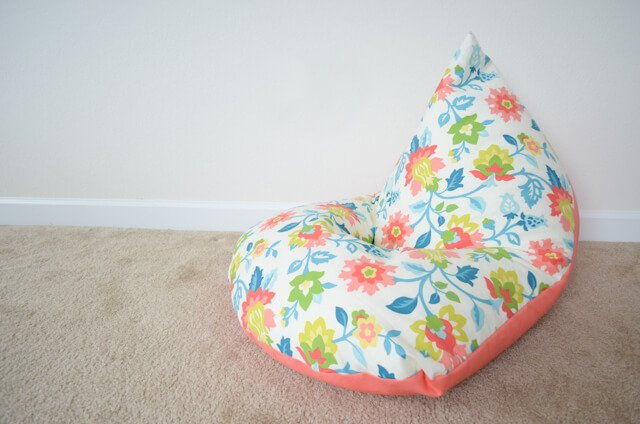 This super cute 30 minute bean bag chair DIY is the perfect seating solution for kids' rooms! This is a project you can't miss if you're looking for cute DIY room décor.