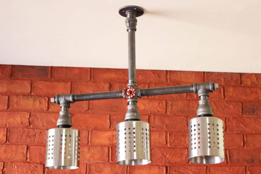 This flush-mounted industrial light fixture is made with heavy industrial pipes and industrial light guard cages. This piece can be customized in several different ways, from substituting galvanized pipes to swapping the light guards for cages. The bulbs are not included in the purchase of the light.