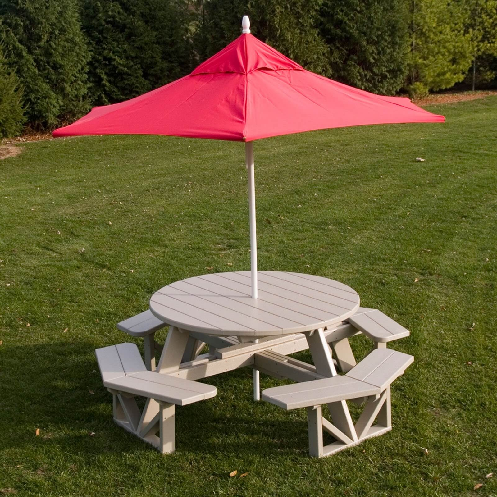 Here is a nice wound plastic picnic table with an umbrella. This higher end picnic table has comfortable seating for up to eight people and plenty of table room for each. One benefit to this design is that everyone at the table can engage directly with one another.
