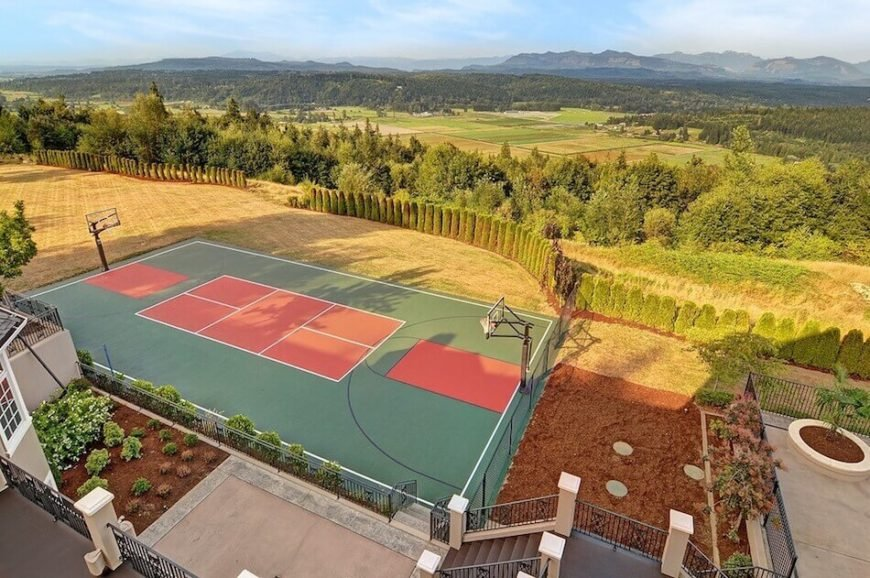 Here is a court with basketball hoops on the long ends of the tennis court. This creates a full basketball court as well as a full tennis court. The tennis court has a bit of an over sized edge but that shouldn't be too much of an issue to most players.