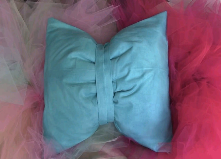 This is a super cute way to recover old pillows! Simply wrap and glue your fabric over pillow forms or old throw pillows!