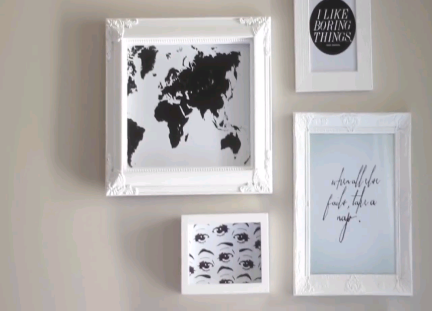 Transform old picture frames into a beautiful gallery wall! Includes tips for mapping out your gallery wall before hanging your pictures!