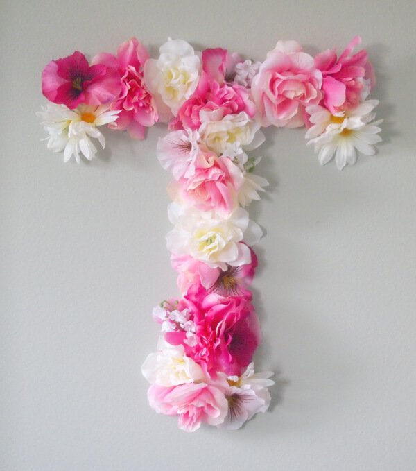 This is an amazing way to create a monogram to hang in your home. The faux flowers make it perfect for spring!