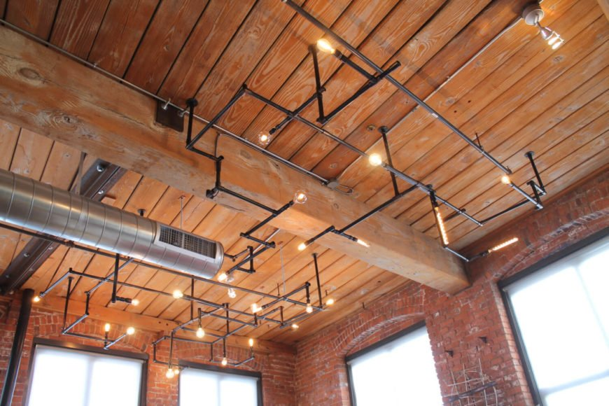 This enormous installation is a network of pipes and light bulbs that would look great in any retail store or in an office setting. The light will cover about 150 to 200 square feet, and utilizes 20 to 24 light bulbs. The listing can be customized to any space and any specs.