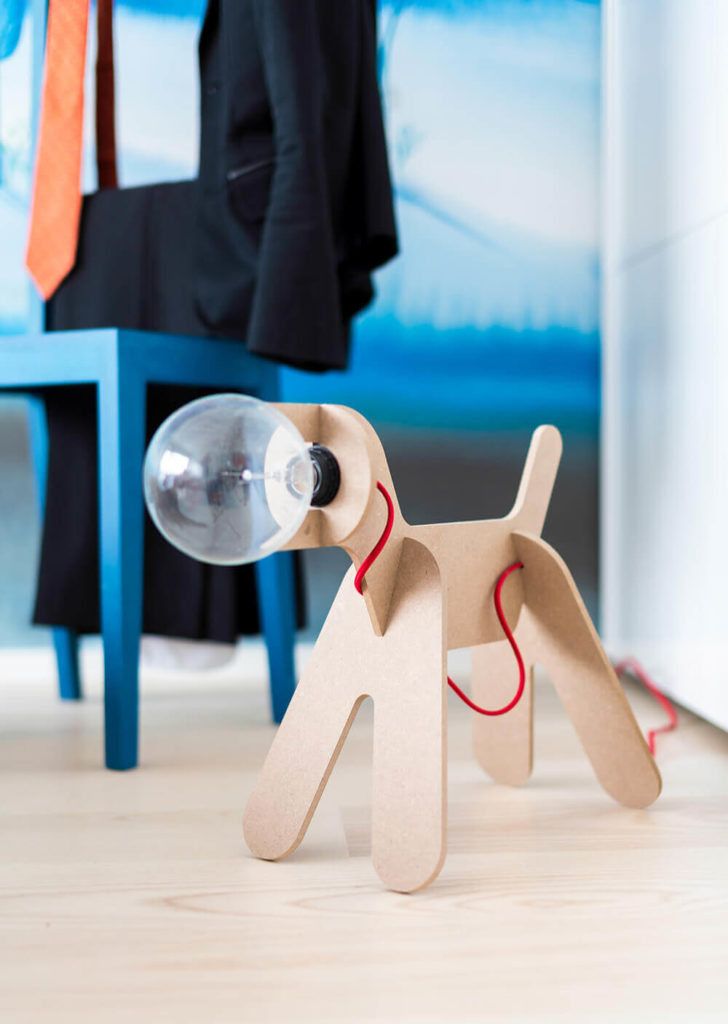 One of many startlingly unique details seen within the home, this dog lamp mixes natural wood and bright red into a magical science fiction design.