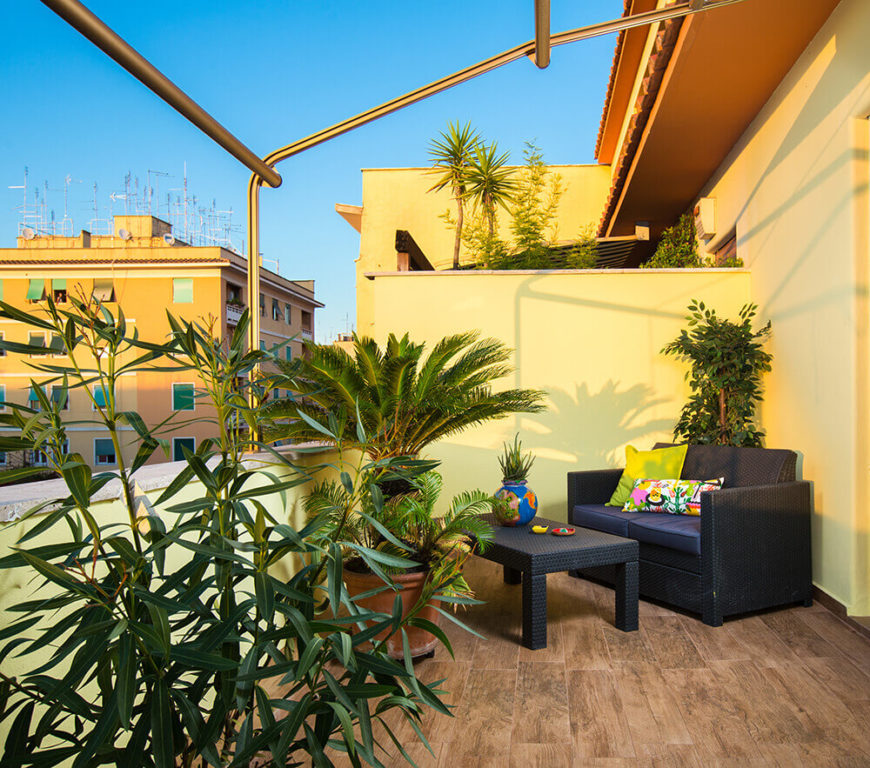 Finally, we have a look at the luxurious terrace, floored with the same hardwood material as the interior for a cohesive look. This cozy space is flush with greenery and enjoys expansive views over Rome.