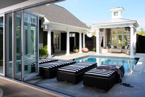 Use decorative elements to tie your gazebo and its furniture into the rest of your design. This gazebo has a splendid black and white striped theme that can be found throughout the rest of the pool area.