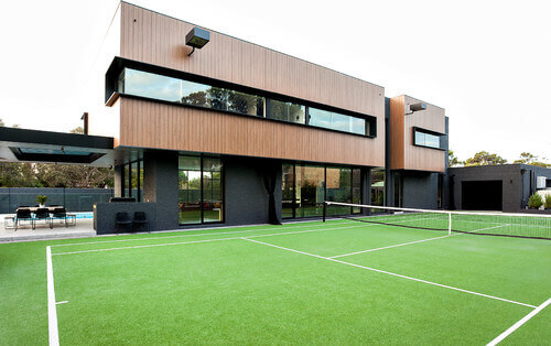 This well maintained tennis court is an amazing place for a game. Because the court is so close to the house, people in the living room or upstairs areas still have a great view of the match.