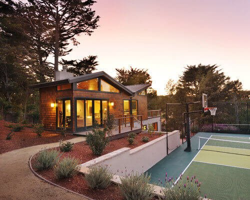Here is a nice mixed sports court. Again, it is a basketball and tennis court. The hoop placed at half court is a great way to make the most of a small space.