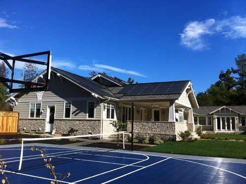 Here is a mixed use sports court that can be used for tennis and basketball. A tennis and basketball court combination is a common choice as they both use similar surfaces. Many choose to have the basketball hoop placed at the center of the tennis court, allowing for a half court basketball space.