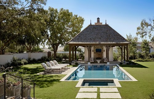 This gazebo has it all! There is a television and a fireplace, and all kinds of seating. With a gazebo as well equipped as this one, you can stay out by the pool all day.