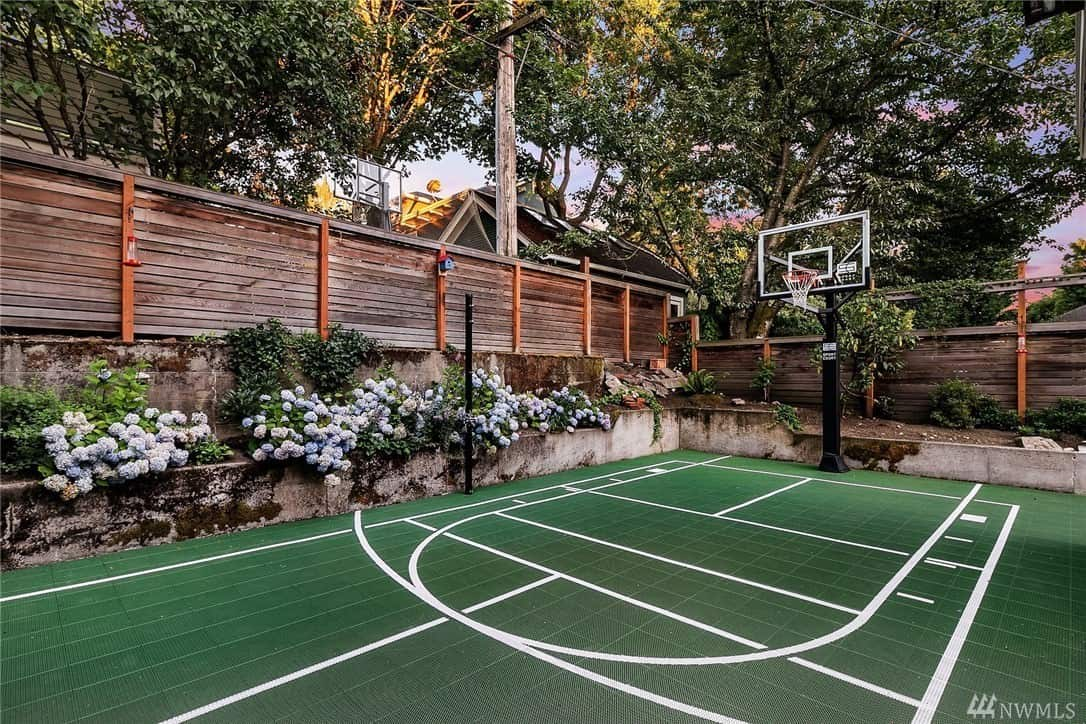Full size green surface backyard basketball court