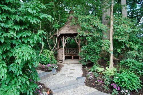 This gazebo made from raw wood has a basic and woodsy look that can really bring you back to nature when you visit your garden.