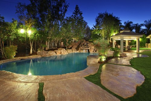 At night, a well lit gazebo can be the beacon to your pool area. When the sun goes down and everyone is done in the pool there is no need to abandon the poolside area with a well lit gazebo like this.