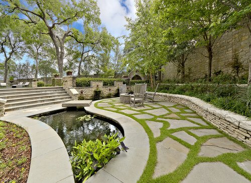 This space has a number of rocks in the ground with well maintained grass between the large stepping stones. Grass is great at filling spaces like this, making your yard look more complete.