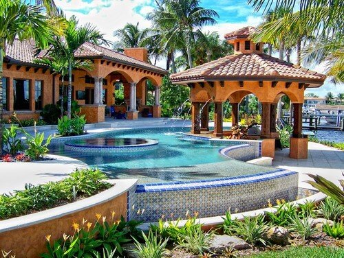 A great feature to include in a poolside gazebo is a fire pit. A fire pit can warm you up after a swim and help you dry off. It will also allow you to hang out late into the night.