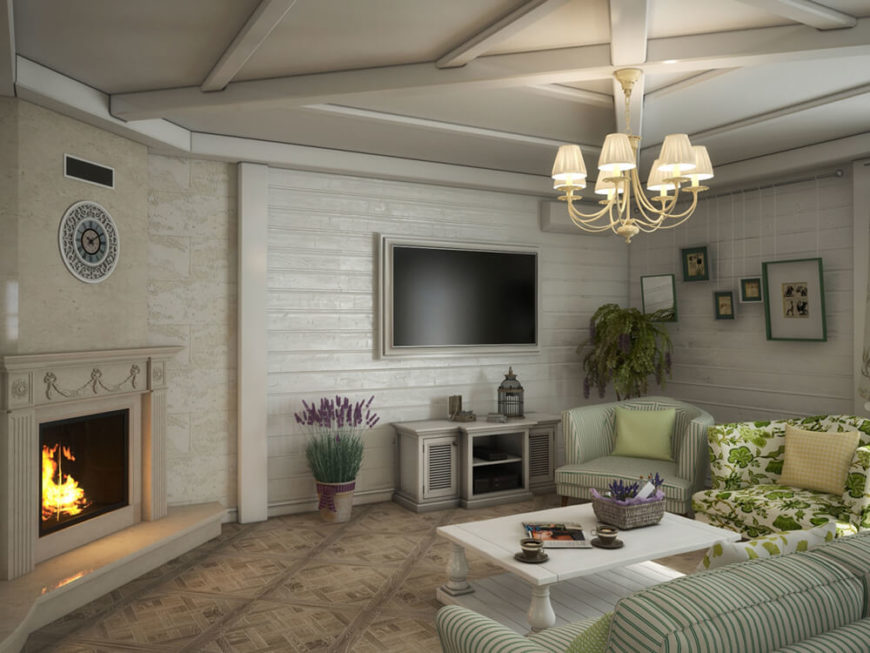 We leave off returning to the living room, to show off the rich marble fireplace standing in the corner. This bold element anchors the lightly colored space without drawing attention to itself.