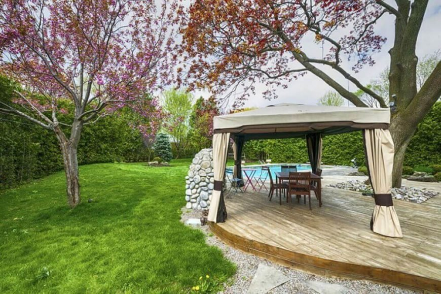 This handsome design was created specifically for this environment, wrapping around a square rock garden with a large tree at the center. Personalized designs are a great advantage of floating decks.