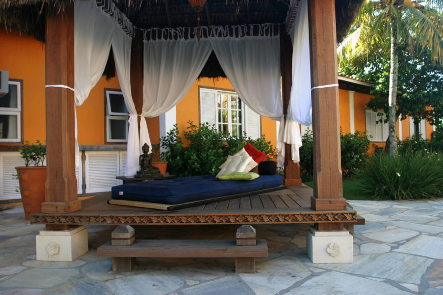 Here is a relaxed and shady gazebo that is perfect for a nice afternoon nap. The sheer curtains provide a nice stylish addition, giving it a luxurious feel. Your patio will be a splendid escape with a prime relaxation gazebo like this.