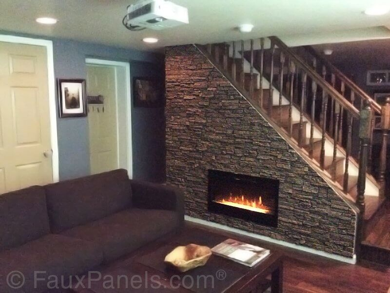 This is a clever idea that makes use of a space that typically goes ignored. The stairwell has been fitted with a gas fireplace and made over with faux layered stone, evoking the sense of a more traditional fireplace.